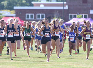 Runners leave the start in the Girls Division 1 varsity race during the Queensbury Invitational cross country meet at Queensbury High School Saturday, September 17, 2016. (Ed Burke/Special to The Times Union)