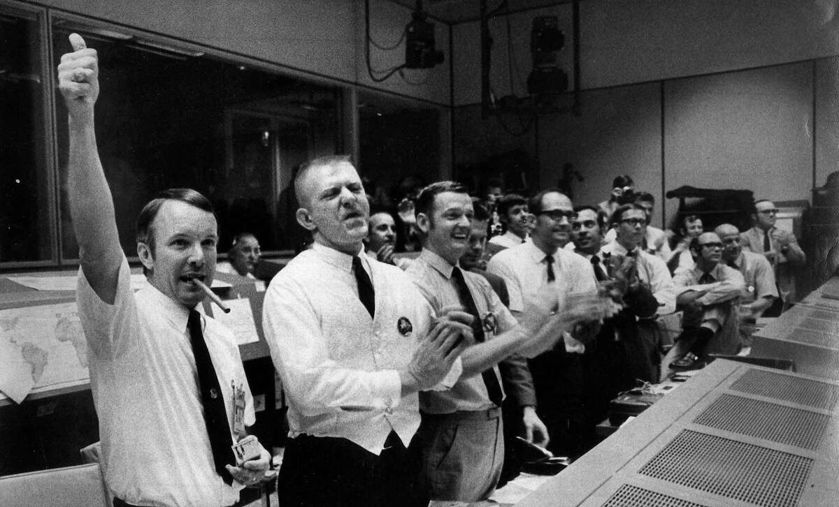 The four Apollo 13 flight crew directors who brought the crippled spacecraft back to Earth celebrate at their post in Mission Control as they learn of the command module's successful splashdown on April 17, 1970. From left are Gerald Griffin, Eugene Kranz, Glynn Lunney and Milton Windler.