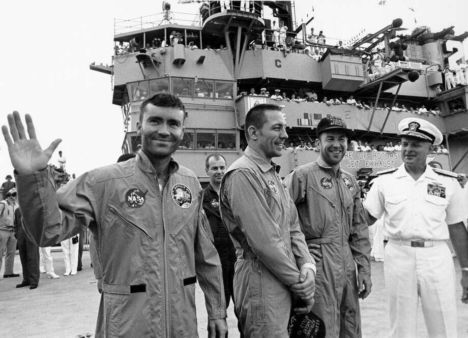 Astronauts Fred Haise, left, Jack Swigert and Jim Lovell are welcomed aboard the U.S. Iwo Jima by Rear Admiral Donald C. Davis. / handout web