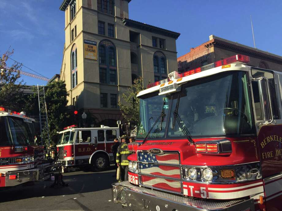 Berkeley firefighters respond to a burning commercial building at the corner of University and Shattuck avenues.