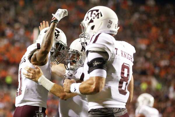 Texas A&M wide receiver Josh Reynolds, left, Texas A&M quarterback Trevor Knight, right, celebrate after Reynolds scores a touchdown during an NCAA college football game against Auburn, Saturday, Sept. 17, 2016, in Auburn, Ala. (AP Photo/Brynn Anderson)