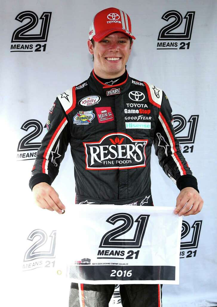 BRISTOL, TN - AUGUST 19:  Erik Jones, driver of the #20 Resers Main Street Bistro Toyota, poses with the 21 Means 21 pole award after qualifying for the pole position for the NASCAR XFINITY Series Food City 300 at Bristol Motor Speedway on August 19, 2016 in Bristol, Tennessee.  (Photo by Sean Gardner/Getty Images)