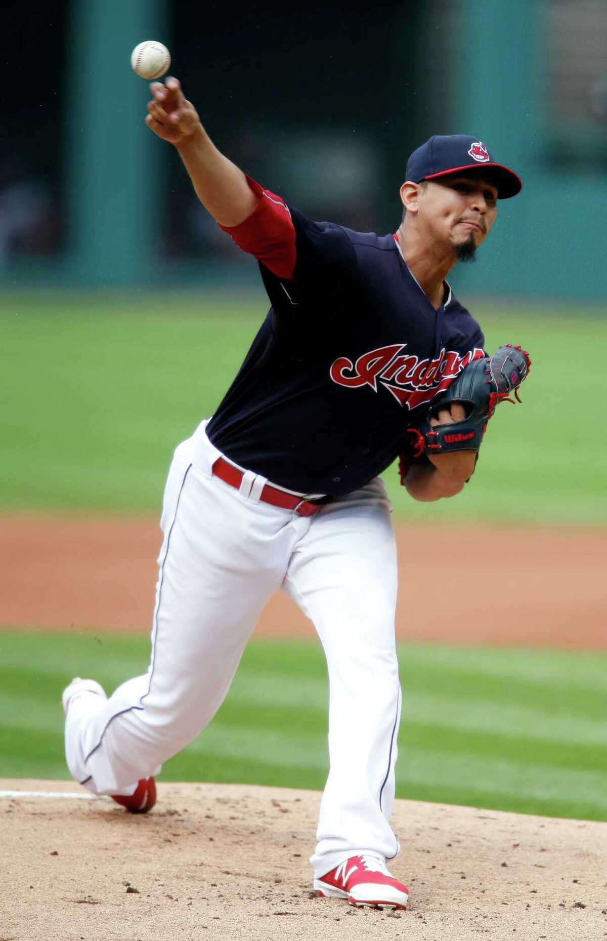 Cleveland Indians starting pitcher Carlos Carrasco delivers against the Detroit Tigers during the first inning of a baseball game Saturday, Sept. 17, 2016, in Cleveland. (AP Photo/Ron Schwane) ORG XMIT: OHRS101