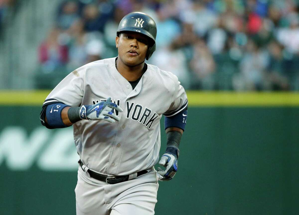 New York Yankees' Starlin Castro rounds the bases after he hit a solo home run against the Seattle Mariners in the second inning of a baseball game, Monday, Aug. 22, 2016, in Seattle. (AP Photo/Ted S. Warren) ORG XMIT: WATW115