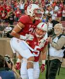 Christian McCaffrey #5 of the Stanford Cardinal celebrates his 1st touchdown with Michael Rector #3 against USC at Stanford, Calif. on September 17th, 2016.