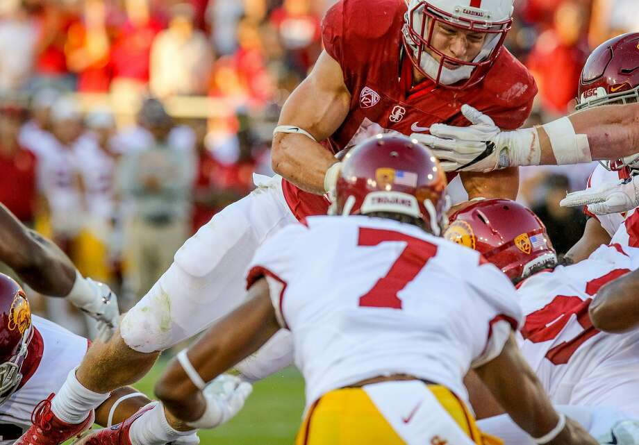 Christian McCaffrey #5 of the Stanford Cardinal shoes his second touchdown against USC at Stanford, Calif. on September 17th, 2016. Photo: John Storey, Special To The Chronicle