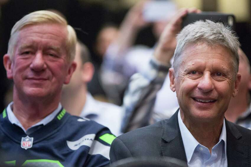 Gary Johnson, the Libertarian Party?•s presidential nominee, and his running mate Bill Weld, left, watch their introductory speakers during a rally at the Sheraton in Seattle on Saturday, Sept. 17, 2016.