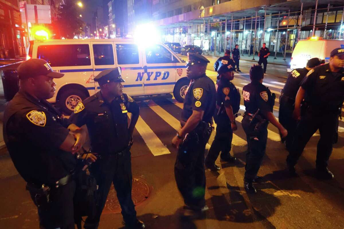 Police block a road after an explosion in New York on September 17, 2016. An explosion in New York's Chelsea neighborhood injured multiple people Saturday night, police said. / AFP PHOTO / William EDWARDSWILLIAM EDWARDS/AFP/Getty Images