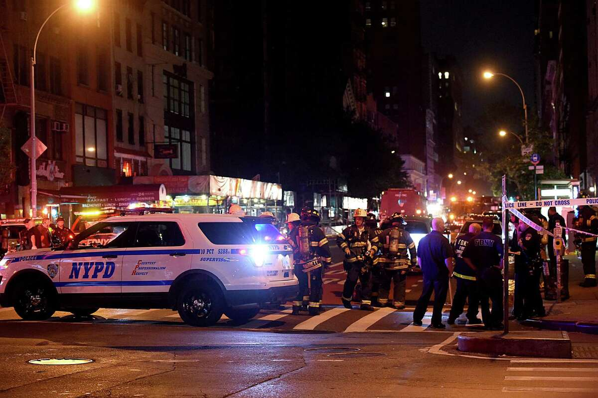 NEW YORK, NY - SEPTEMBER 17: Police officers and firefighters respond to an explosion on September 17, 2016 at 23rd Street and 7th Avenue in the Chelsea neighborhood of New York City. According to reports, over 20 people have been taken to hospitals with injuries, none of which are thought to be life threatening. (Photo by Jamie McCarthy/Getty Images) ORG XMIT: 670454571