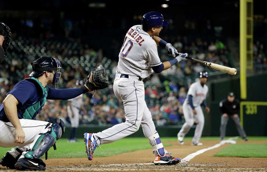 Houston Astros' Yulieski Gurriel singles in a pair of runs as Seattle Mariners cacher Mike Zunino watches during the sixth inning of a baseball game Saturday, Sept. 17, 2016, in Seattle. (AP Photo/Elaine Thompson) Photo: Elaine Thompson, Associated Press / Copyright 2016 The Associated Press. All rights reserved.