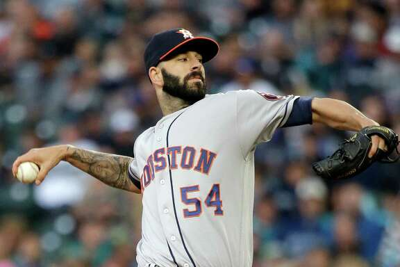 Houston Astros starting pitcher Mike Fiers throws against the Seattle Mariners during the first inning of a baseball game Saturday, Sept. 17, 2016, in Seattle. (AP Photo/Elaine Thompson)