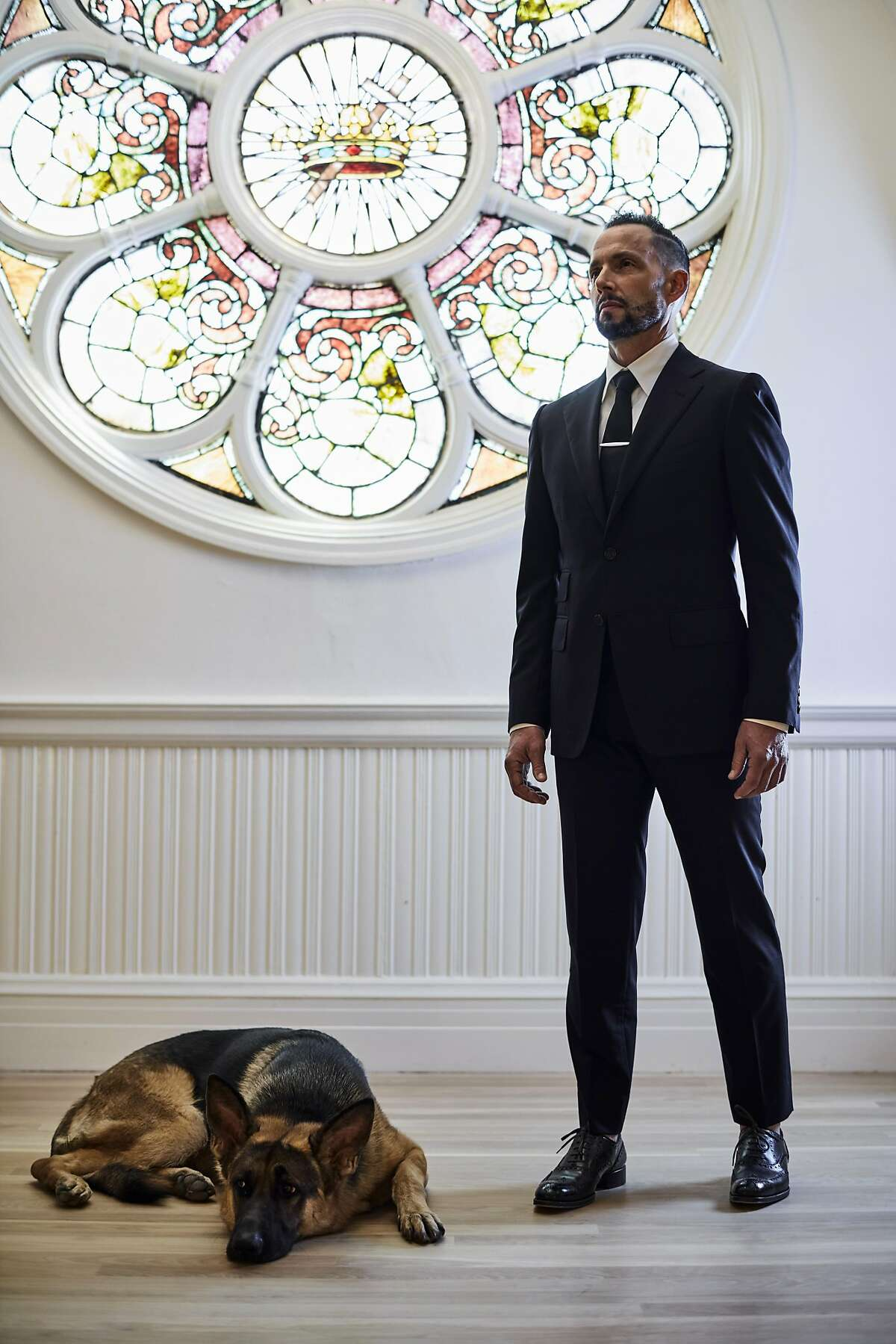 Jeremy Kidson, owner of designer discount store Jeremy's, photographed with his dog Rocco inside his new store in an old church in downtown Oakland on Sept 16, 2016.
