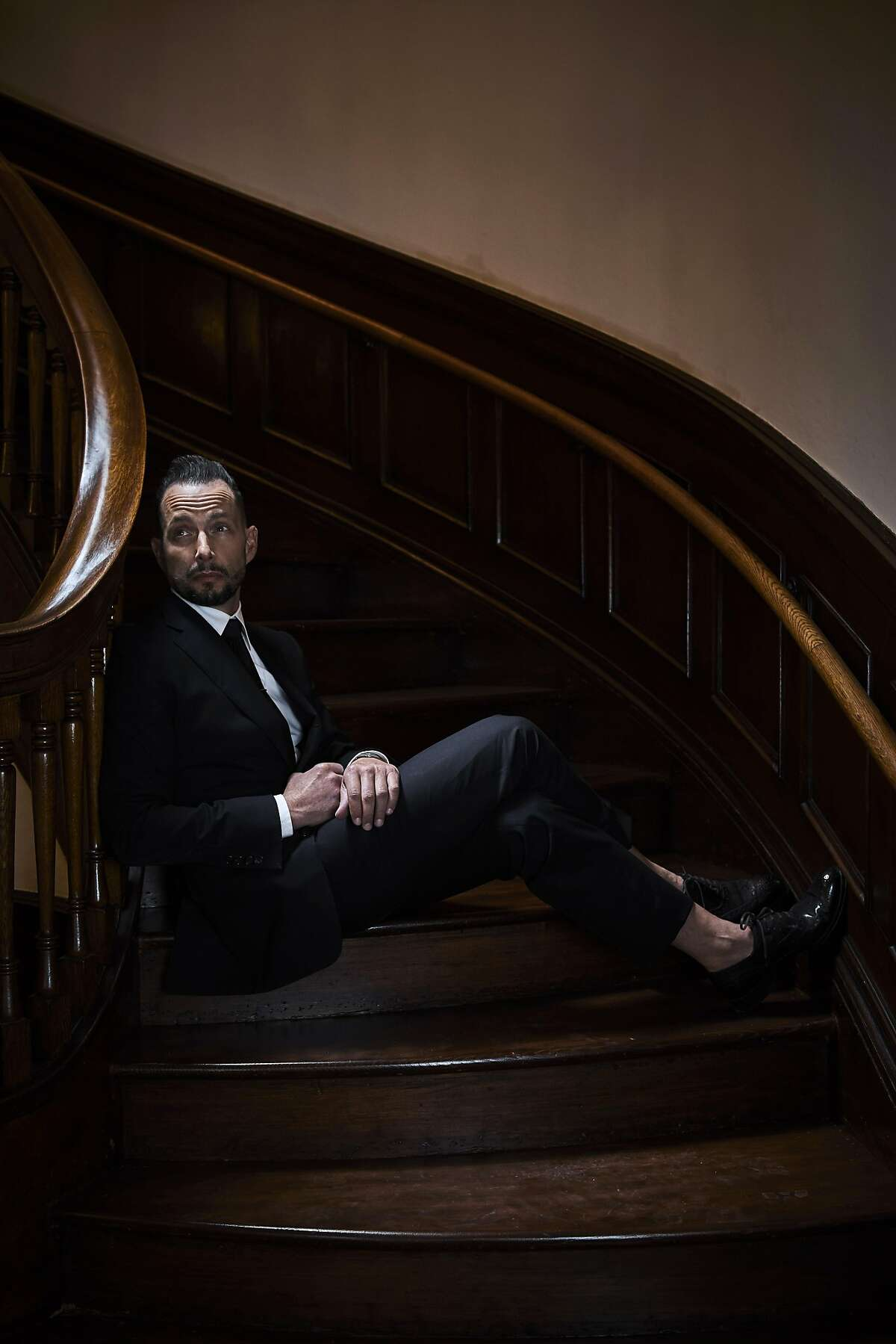 Jeremy Kidson, owner of designer discount store Jeremy's, photographed on the grand staircase inside his new store in an old church in downtown Oakland on Sept 16, 2016.