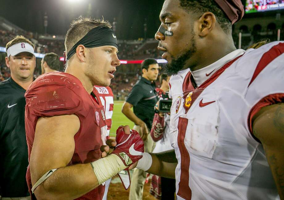 Stanford's Heisman contender Christian McCaffrey (left), who had two touchdowns Saturday, greets USC wide receiver Darreus Rogers after the Cardinal's win. Photo: John Storey, Special To The Chronicle