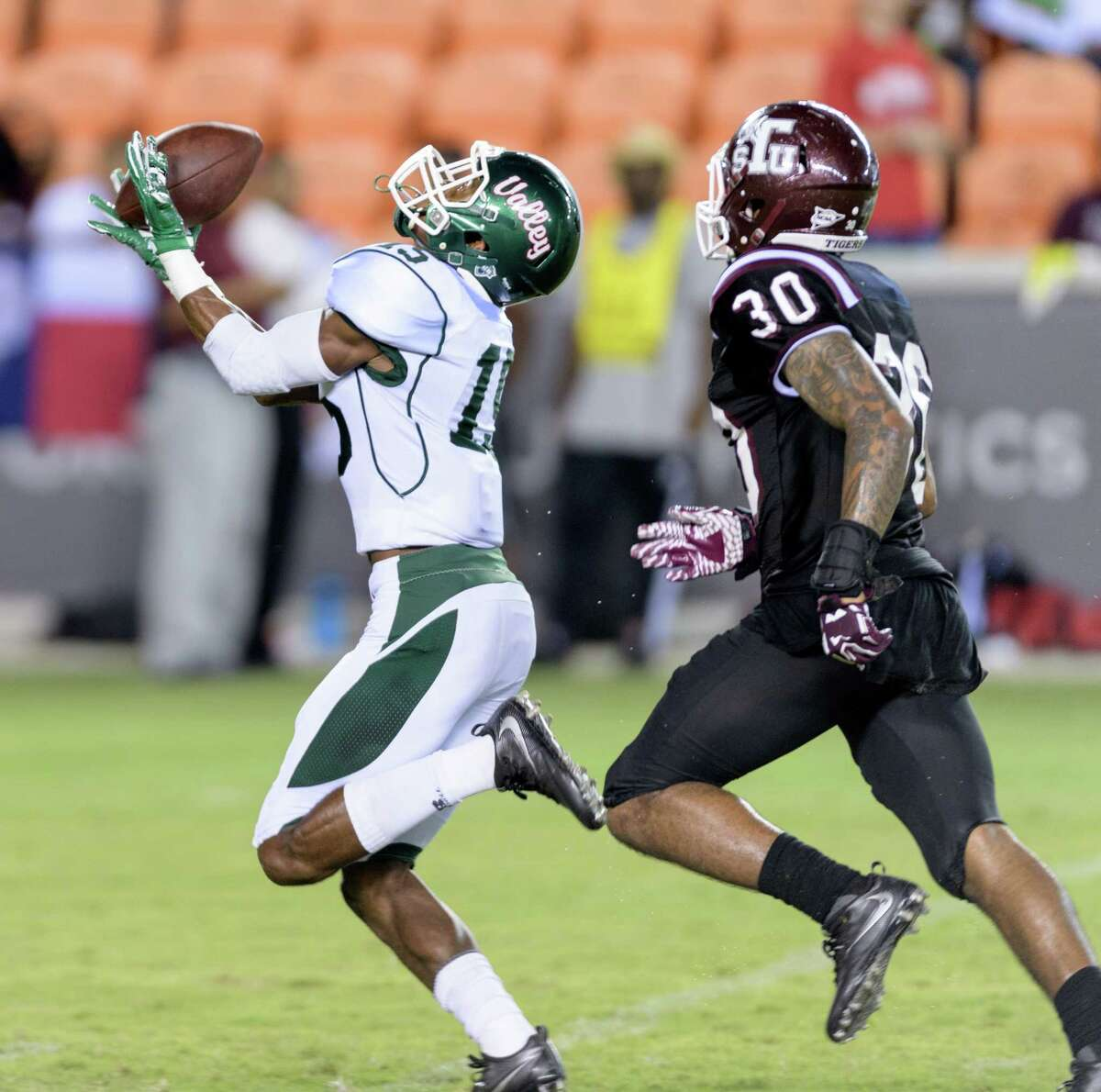 Grant Simms (15) of the Mississippi Valley State Devils bobbles a pass in the second half against the TSU Tigers in a SWAC college football game on Saturday, September 17, 2016 at BBVA Compass Stadium in Houston Texas.