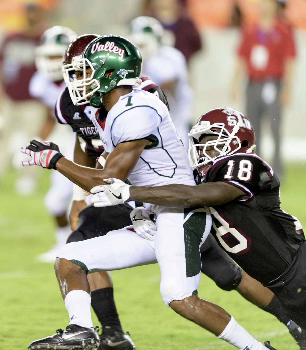 Tre Simms (7) of the Mississippi Valley State Devils is brought down by Jeremiah Credit (18) of the TSU Tigers in the second half of a SWAC college football game on Saturday, September 17, 2016 at BBVA Compass Stadium in Houston Texas.
