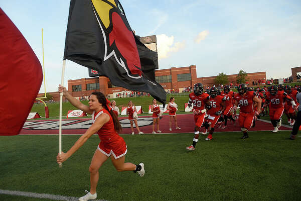 Lamar's cheerleaders lead the charge into the stadium as they get ready for the start of game action against Sam Houston State Saturday at Provost-Umphrey Stadium. Photo taken Saturday, September 17, 2016 Kim Brent/The Enterprise