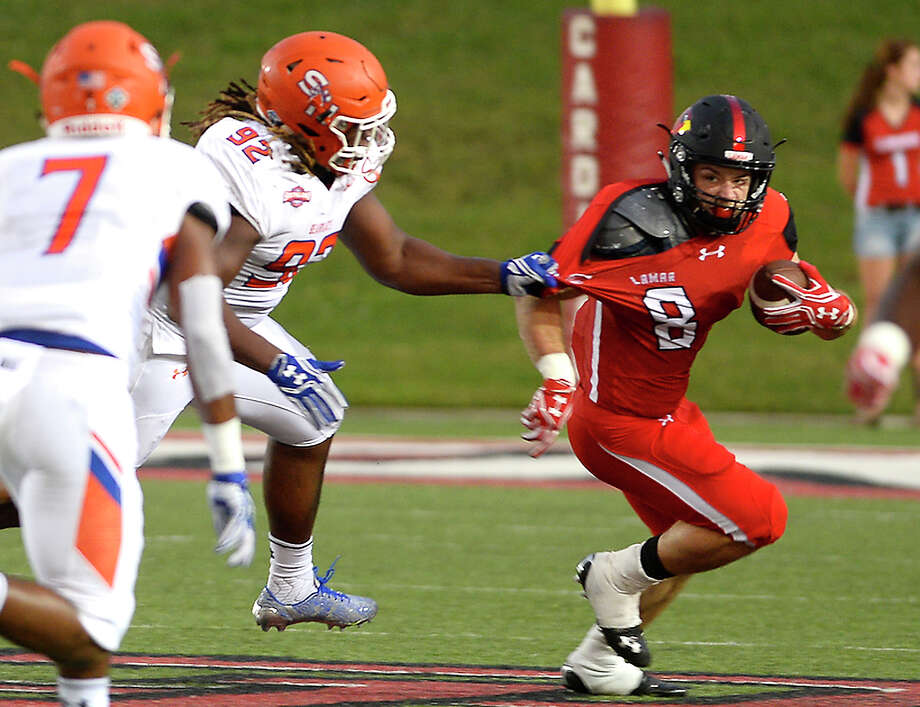 Lamar's Kade Harrington is snagged for the tackle by Sam Houston State's P. J. Hall during Saturday's conference game at Provost-Umphrey Stadium. Photo taken Saturday, September 17, 2016 Kim Brent/The Enterprise Photo: Kim Brent / Beaumont Enterprise
