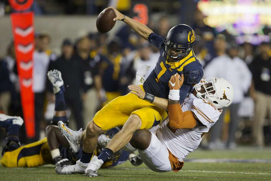 BERKELEY, CA - SEPTEMBER 17:  Outside linebacker Malcolm Roach #32 of the Texas Longhorns sacks quarterback Davis Webb #7 of the California Golden Bears in the second quarter on September 17, 2016 at California Memorial Stadium in Berkeley, California.  (Photo by Brian Bahr/Getty Images) Photo: Brian Bahr/Getty Images