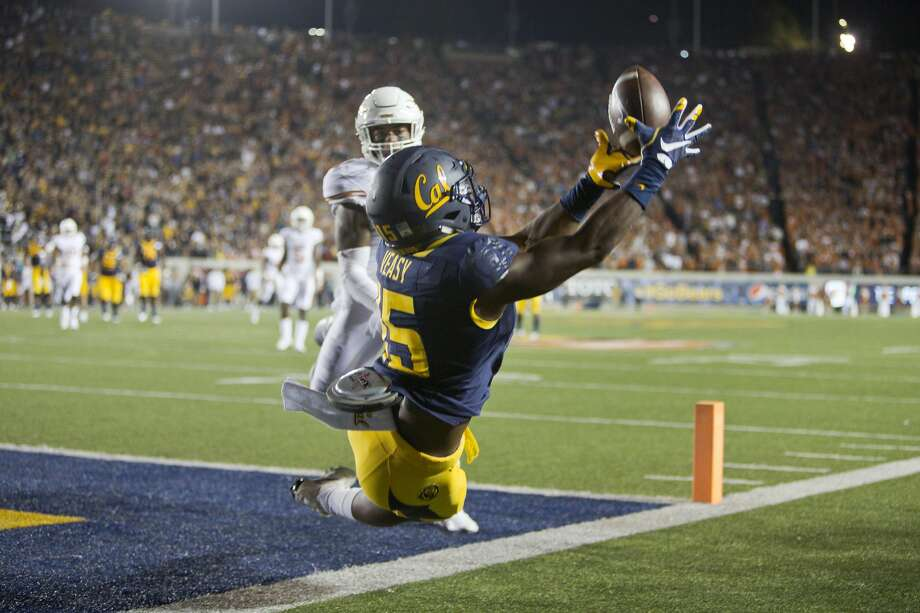 BERKELEY, CA - SEPTEMBER 17:  Wide receiver Jordan Veasy #15 of the California Golden Bears can't get his feet in bounds for a touchdown against safety P.J. Locke III #11 of the Texas Longhorns in the first quarter on September 17, 2016 at California Memorial Stadium in Berkeley, California.  (Photo by Brian Bahr/Getty Images) Photo: Brian Bahr/Getty Images