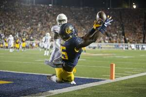 BERKELEY, CA - SEPTEMBER 17:  Wide receiver Jordan Veasy #15 of the California Golden Bears can't get his feet in bounds for a touchdown against safety P.J. Locke III #11 of the Texas Longhorns in the first quarter on September 17, 2016 at California Memorial Stadium in Berkeley, California.  (Photo by Brian Bahr/Getty Images)