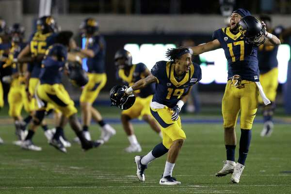 California players, including Vic Wharton III (17,) celebrate the team's 50-43 defeat of Texas, at the end of an NCAA college football game Saturday, Sept. 17, 2016, in Berkeley, Calif. (AP Photo/Ben Margot)
