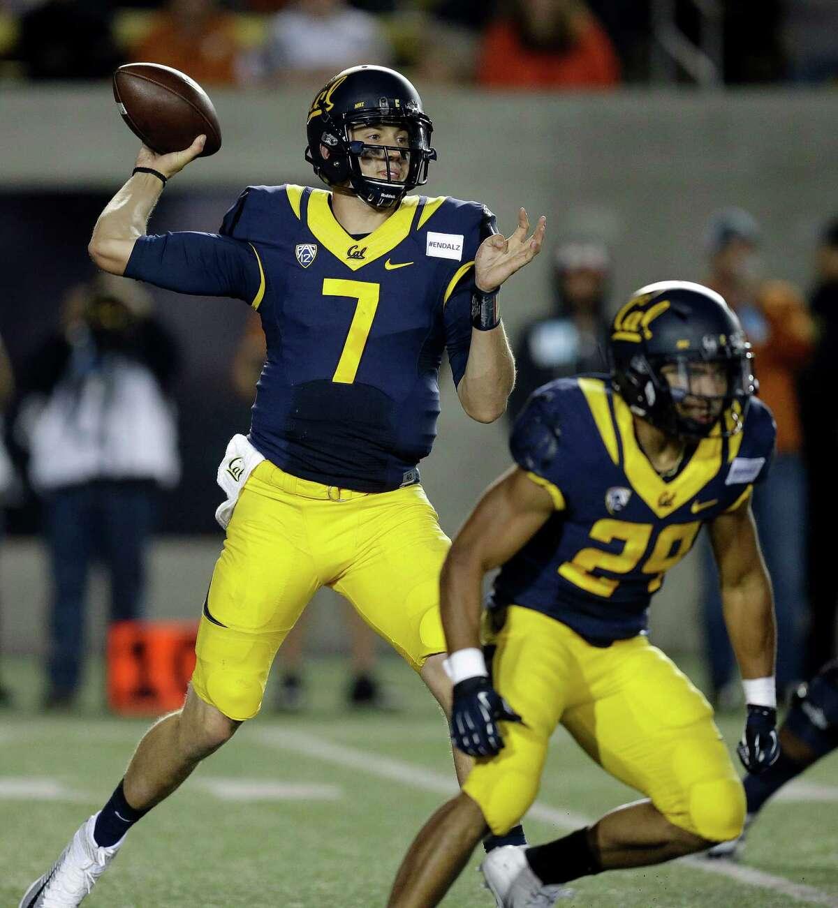 California quarterback Davis Webb (7) passes against Texas during the second half of an NCAA college football game Saturday, Sept. 17, 2016, in Berkeley, Calif. California won, 50-43. (AP Photo/Ben Margot)