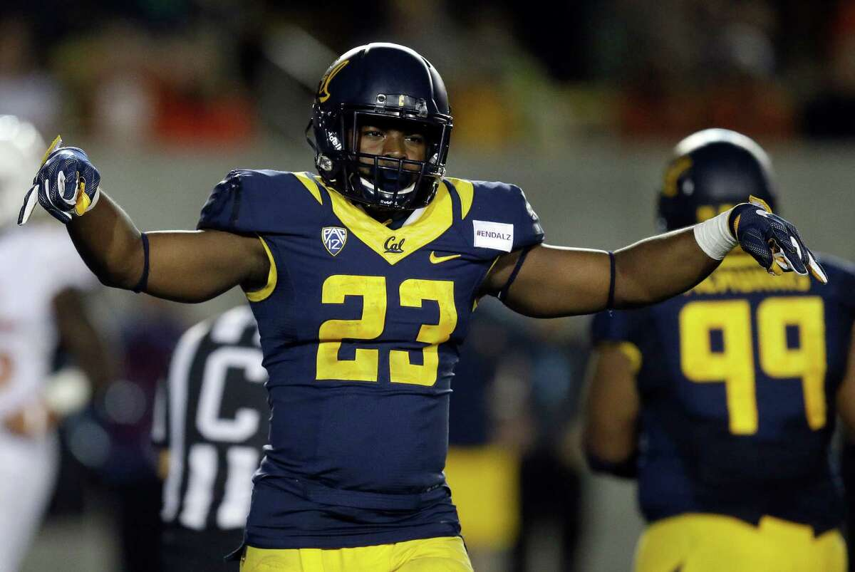 California's Vic Enwere (23) celebrates a touchdown made by Chad Hansen during the second half of an NCAA college football game against Texas on Saturday, Sept. 17, 2016, in Berkeley, Calif. California won 50-43. (AP Photo/Ben Margot)