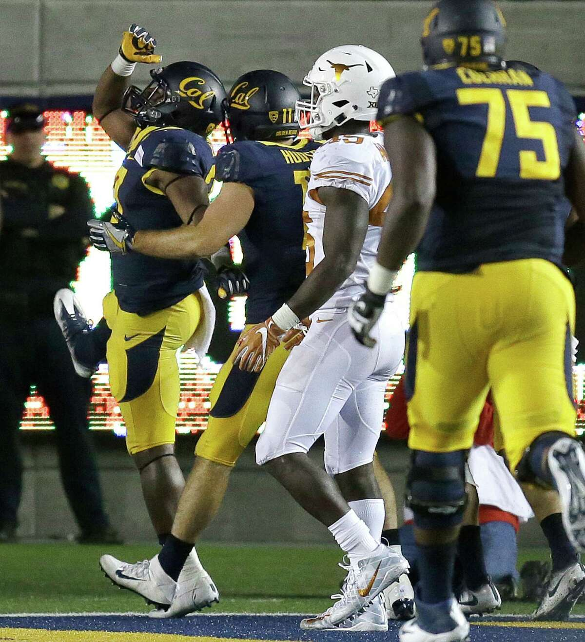 California's Vic Enwere, left, celebrates with Raymond Hudson after scoring a touchdown against Texas during the fourth quarter of an NCAA college football game Saturday, Sept. 17, 2016, in Berkeley, Calif. California won 50-43. (AP Photo/Ben Margot)