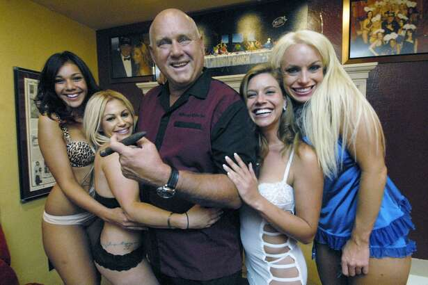 """In this Thursday, June 26, 2008, file photo, Owner Dennis Hof poses with some of his """"working girls"""" in the parlor of his Moonlite BunnyRanch in Mound House, east of Carson City, Nev. Dennis Hof doesn't lack for name recognition in his run for Nevada Assembly. He starred in an HBO reality series called """"Cathouse"""" and relished the spotlight when NBA player Lamar Odom suffered a medical episode during a stay at a legal brothel Hof owned. (Lisa J. Tolda/The Reno Gazette-Journal via AP, File)"""