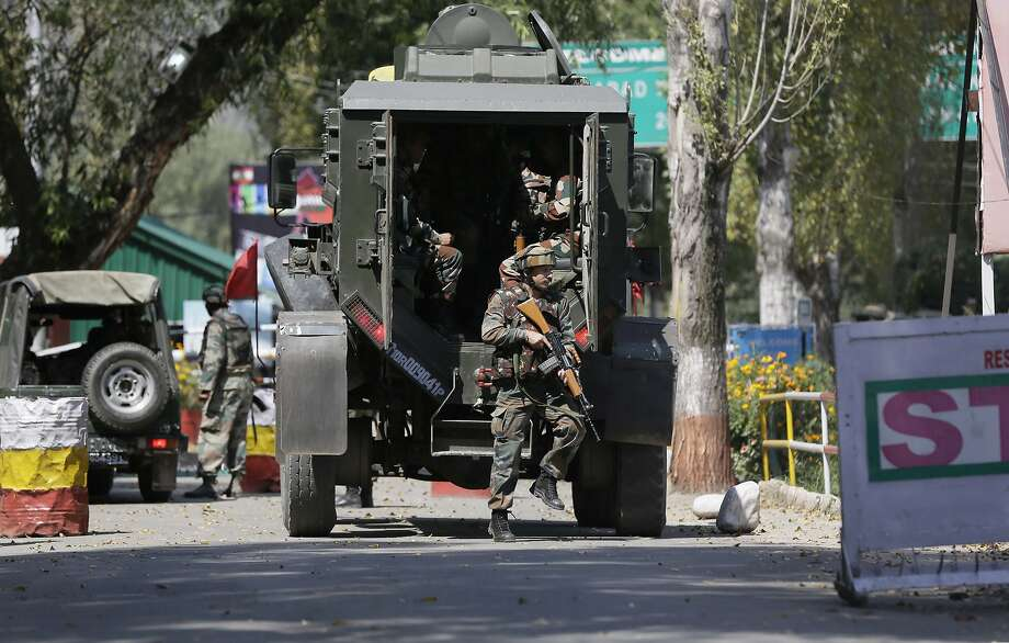 Soldiers arrive at the army base that was attacked by rebels in the town of Uri in Indian-controlled Kashmir. At least four rebels died in the assault. Photo: Mukhtar Khan, Associated Press