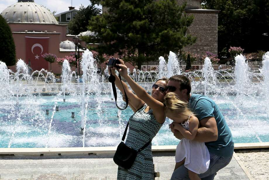 A family visiting Istanbul takes a selfie in July at the Byzantine-era Hagia Sophia museum. Photo: Petros Karadjias, Associated Press