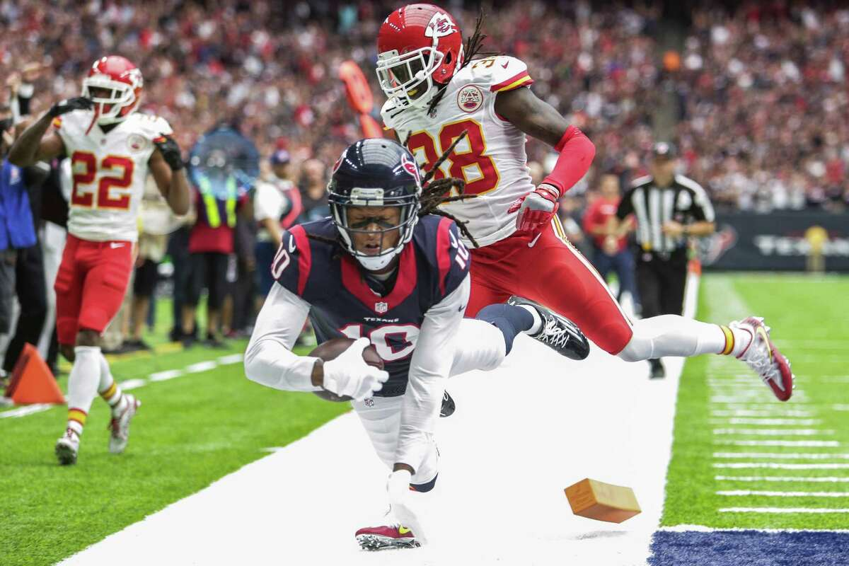 Houston Texans wide receiver DeAndre Hopkins (10) dives into the end zone for a touchdown past Kansas City Chiefs free safety Ron Parker (38) during the first quarter of an NFL game at NRG Stadium Sunday, Sept. 18, 2016 in Houston.