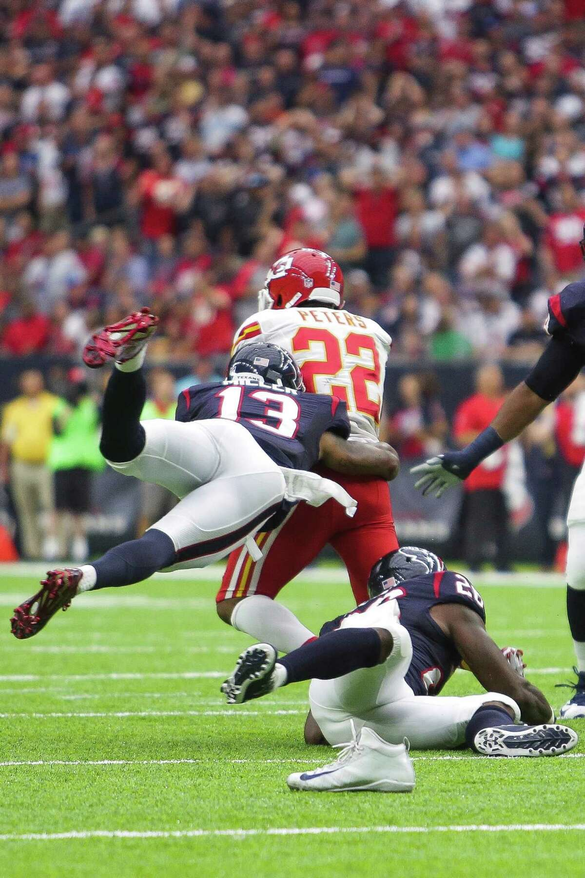 Houston Texans wide receiver Braxton Miller (13) tackles Kansas City Chiefs cornerback Marcus Peters (22) after Peters caught an interception during the first quarter of an NFL game at NRG Stadium Sunday, Sept. 18, 2016 in Houston.