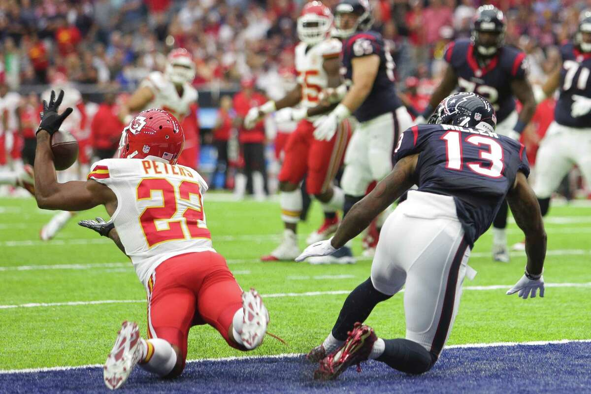 Kansas City Chiefs cornerback Marcus Peters (22) intercepts a pass intended for Houston Texans wide receiver Braxton Miller (13) during the first quarter of an NFL game at NRG Stadium Sunday, Sept. 18, 2016 in Houston.