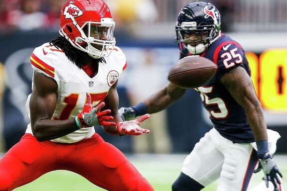 Kansas City Chiefs wide receiver Chris Conley (17) makes a catch while being pursued by Houston Texans cornerback Kareem Jackson (25) during the first quarter of an NFL game at NRG Stadium Sunday, Sept. 18, 2016 in Houston.