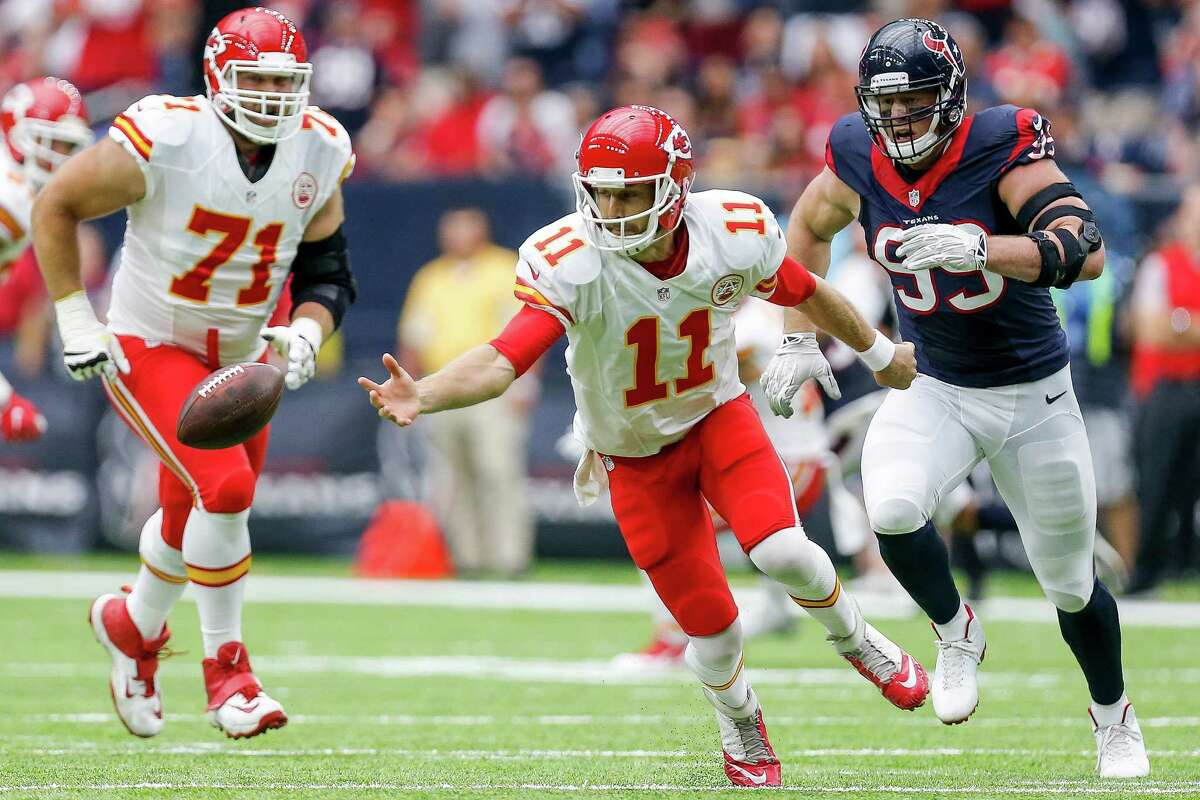 Kansas City Chiefs quarterback Alex Smith (11) chases after a fumbled snap as Houston Texans defensive end J.J. Watt (99) moves in to recover the ball during the first quarter of an NFL game at NRG Stadium Sunday, Sept. 18, 2016 in Houston.
