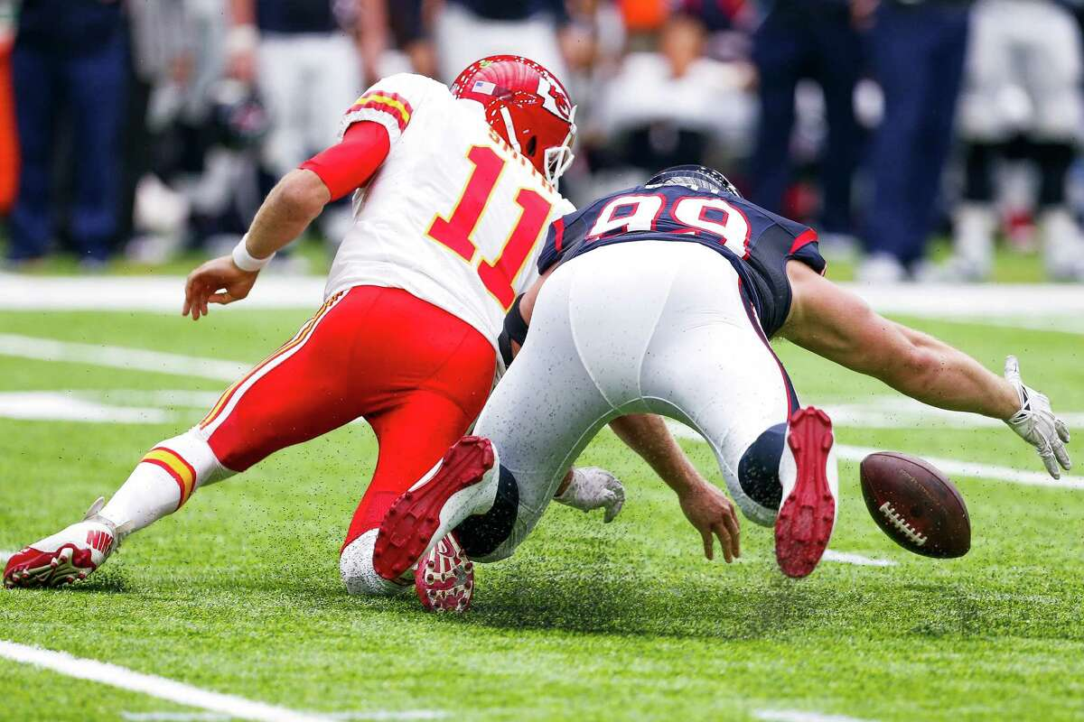 Houston Texans defensive end J.J. Watt (99) recovers a fumbled snap from Kansas City Chiefs quarterback Alex Smith (11) during the first quarter of an NFL football game at NRG Stadium on Sunday, Sept. 18, 2016, in Houston.