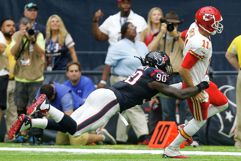 Houston Texans defensive end Jadeveon Clowney (90) dives to tackle Kansas City Chiefs quarterback Alex Smith (11) during the second quarter of an NFL game at NRG Stadium Sunday, Sept. 18, 2016 in Houston. Photo: Michael Ciaglo, Houston Chronicle / © 2016  Houston Chronicle