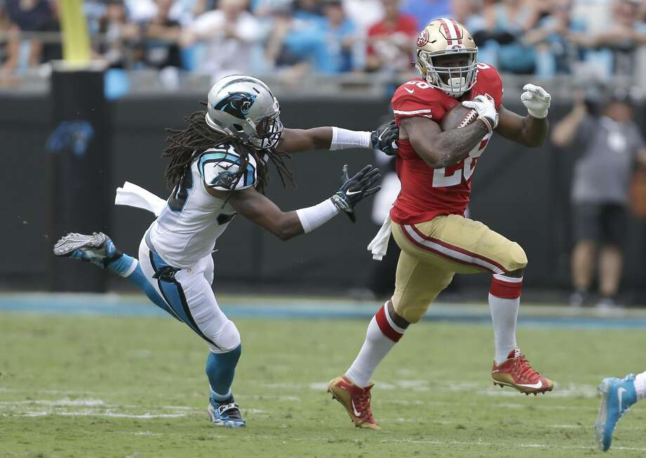 San Francisco 49ers' Carlos Hyde (28) runs as Carolina Panthers' Tre Boston (33) defends in the first quarter of an NFL football game in Charlotte, N.C., Sunday, Sept. 18, 2016. (AP Photo/Bob Leverone) Photo: Bob Leverone, Associated Press