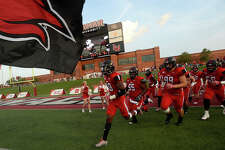 Lamar's Cardinals take the field to face Sam Houston State during Saturday's conference game at Provost-Umphrey Stadium. Photo taken Saturday, September 17, 2016 Kim Brent/The Enterprise