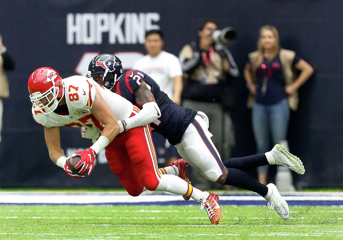 Houston Texans cornerback A.J. Bouye (21) tackles Kansas City Chiefs tight end Travis Kelce (87) during the fourth quarter of an NFL football game at NRG Stadium, Sunday, Sept. 18, 2016 in Houston.