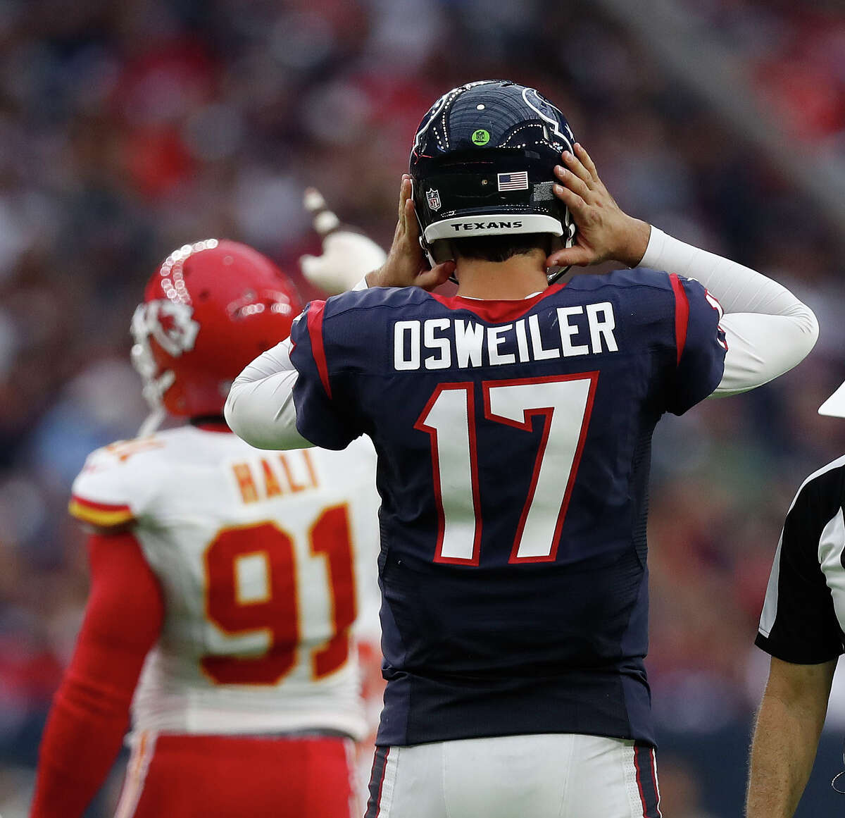 Houston Texans quarterback Brock Osweiler (17) listens to a coach during the fourth quarter of an NFL football game at NRG Stadium, Sunday, Sept. 18, 2016 in Houston.