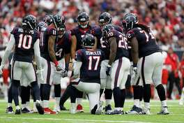 Houston Texans quarterback Brock Osweiler (17) calls a play in the huddle during the fourth quarter of an NFL football game at NRG Stadium, Sunday, Sept. 18, 2016 in Houston.