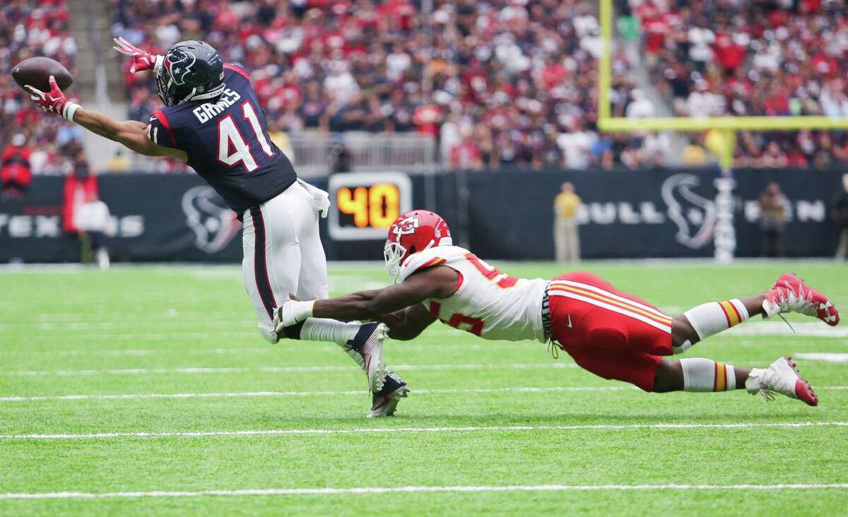Houston Texans running back Jonathan Grimes (41) misses a pass while being defended by Kansas City Chiefs outside linebacker Dee Ford (55) during the second half of an NFL game at NRG Stadium Sunday, Sept. 18, 2016 in Houston.