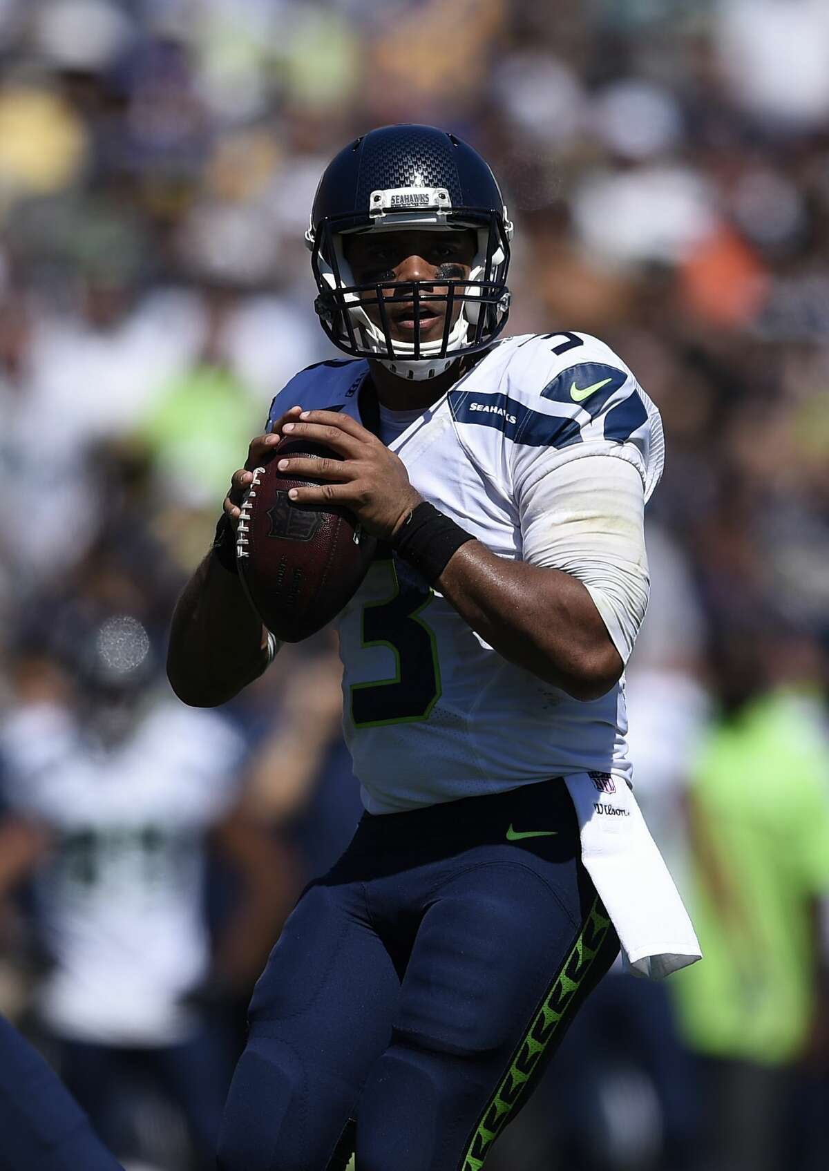 Seattle Seahawks quarterback Russell Wilson gets set to pass during the first half an NFL football game against the Los Angeles Rams at the Los Angeles Memorial Coliseum, Sunday, Sept. 18, 2016, in Los Angeles. (AP Photo/Kelvin Kuo)