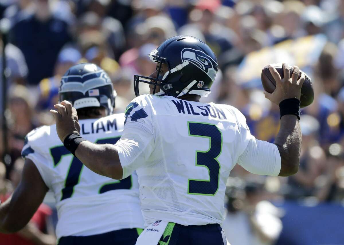 Seattle Seahawks quarterback Russell Wilson passes during the first half an NFL football game against the Los Angeles Rams at Los Angeles Memorial Coliseum, Sunday, Sept. 18, 2016, in Los Angeles. (AP Photo/Jae Hong)