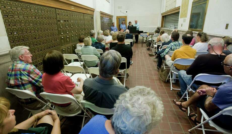 The city of Stamford's historic preservation advisory commission hosts a 375th anniversary celebration centered around the plans to retain and restore the historic Atlantic Street Post Office. Visitors listen to a talk on the future plans of the Post Office. Saturday, Sept. 17, 2016 Photo: Scott Mullin / For Hearst Connecticut Media / The News-Times Freelance