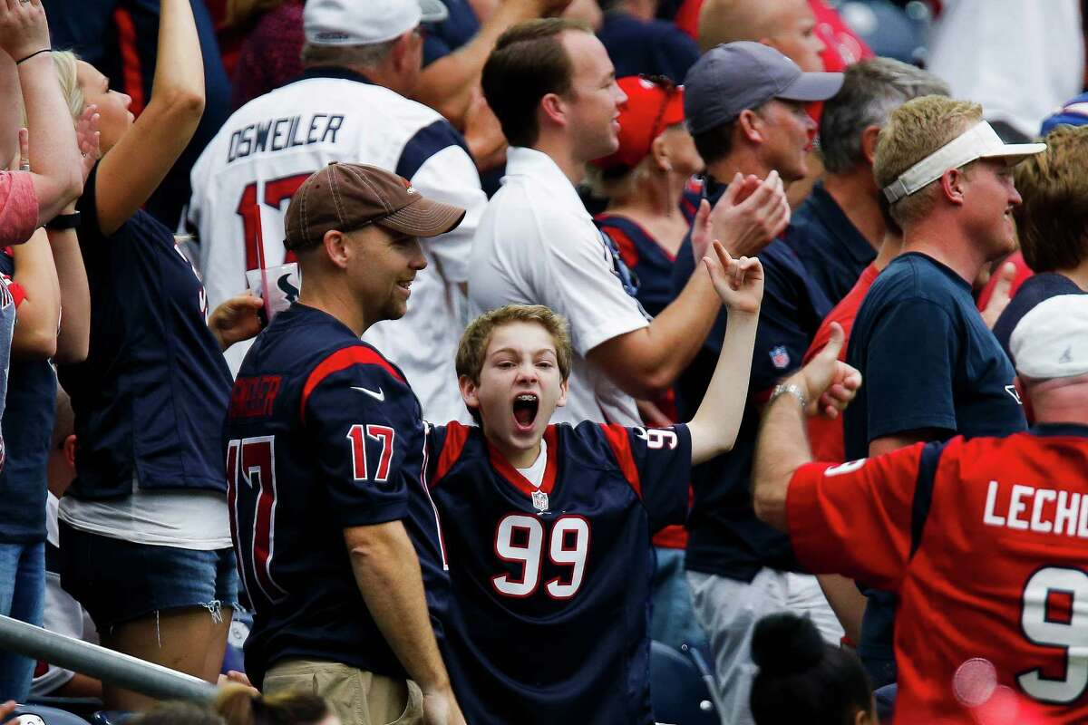A fan reacts as the Houston Texans defense make a stop on third down during the second half of an NFL game at NRG Stadium Sunday, Sept. 18, 2016 in Houston. Browse through the photos to see where you can get free stuff this week because of the Texans' win.