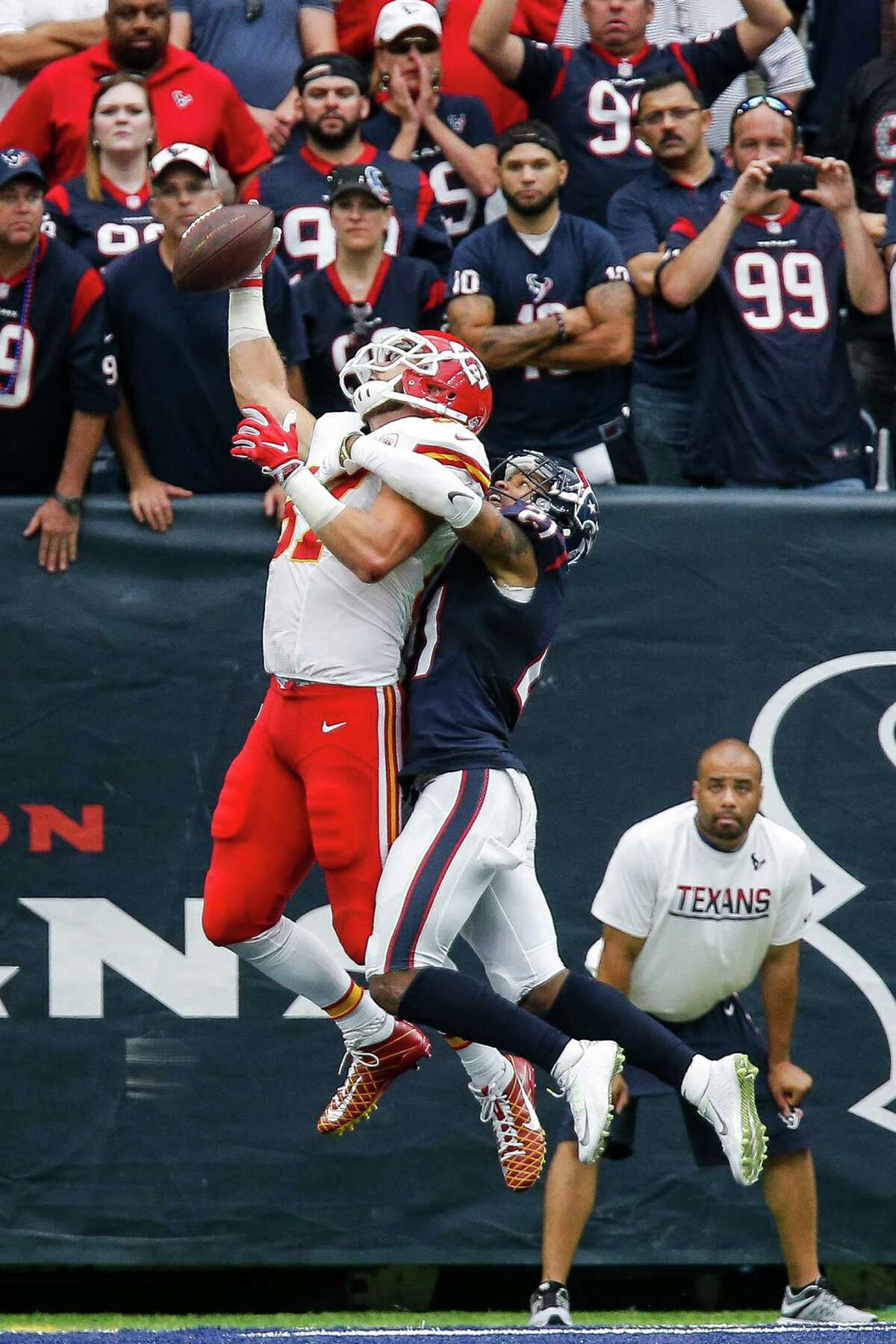 Houston Texans cornerback A.J. Bouye (21) puts on the pressure as Kansas City Chiefs tight end Travis Kelce (87) misses a touchdown pass during the second half of an NFL game at NRG Stadium Sunday, Sept. 18, 2016 in Houston.